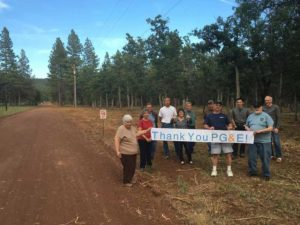 Participating residents gather along Old Country Road after a section of treatment was recently completed.
